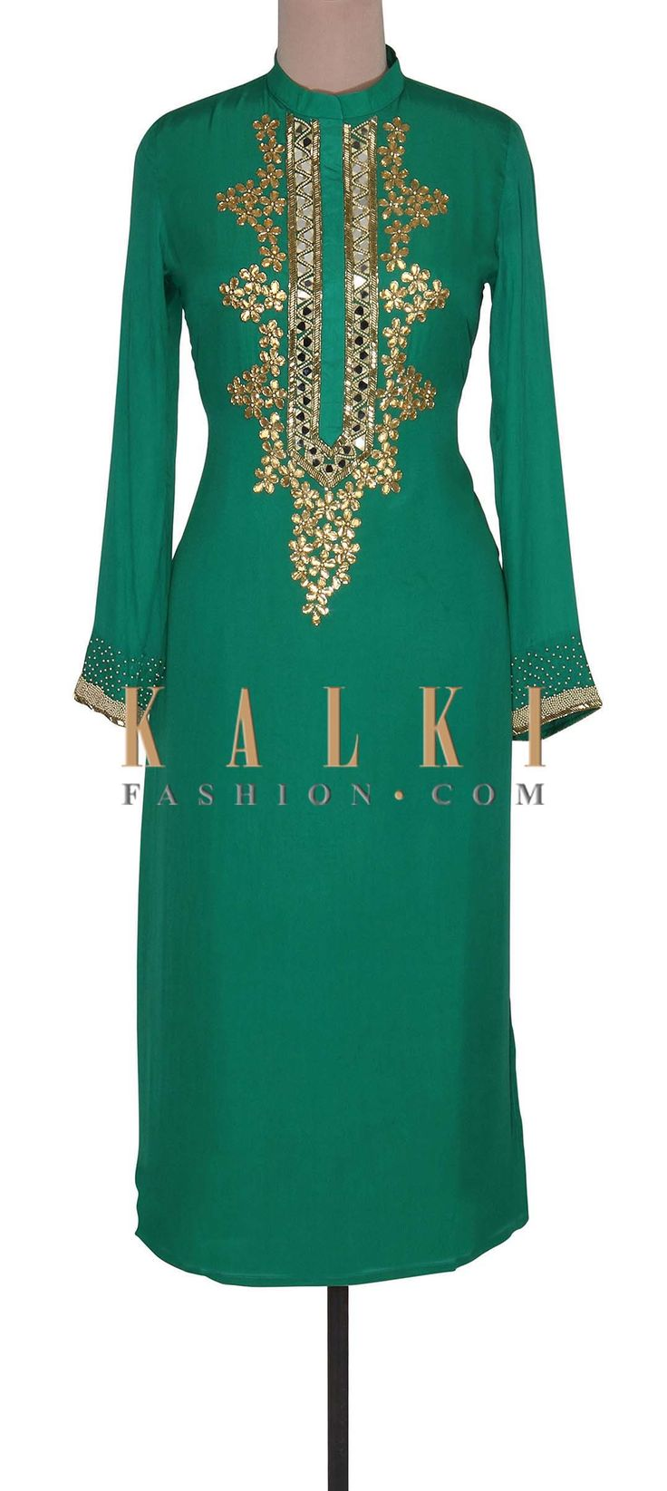 Buy Online from the link below. We ship worldwide (Free Shipping over US$100). Product SKU - 302354. Product Link - http://www.kalkifashion.com/green-suit-adorn-in-mirror-and-gotta-patch-work-only-on-kalki.html