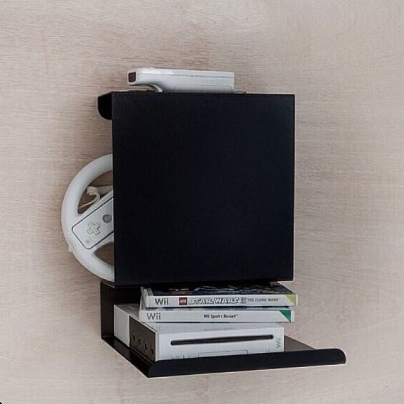 Ledge:able shelf holding the playing console in the kids room