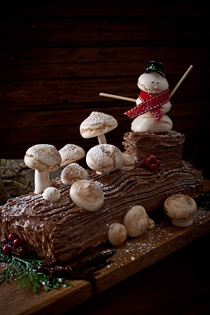 Buche do Noel. It's a rolled cake decorated for Christmas. The family likes lemon roll cake. This might be another option...