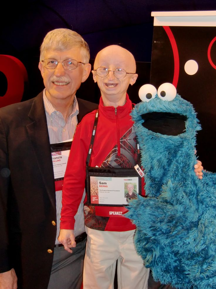 """This weekend, in a heartbreaking phone call from his parents, I learned of the death of Sam Berns, a courageous young man with Hutchinson-Gilford Progeria Syndrome. Sam may have only lived 17 years, but in his short life he taught the rest of us a lot about how to live."" - NIH Director Francis Collins on 1/12/2013. Photo of Collins with cookie monster and Sam Berns at TEDMED 2012"
