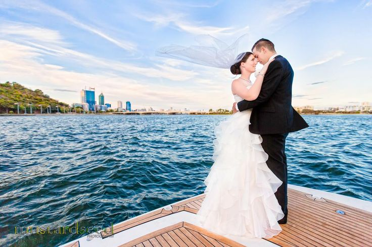 """One more photo from Sarah and Barry's wedding where we positioned ourselves at the back of the """"Princess Helena"""" yacht to capture the beautiful Swan River and Perth's skyline"""
