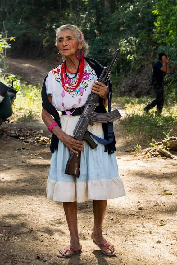 woman, part of Mexico's female vigilante squads fighting cartels.  A woman's place is in the revolution