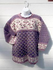"""A drop-shoulder, long sleeved pullover with stranded bands at hem, cuff and yoke, and """"pie crust"""" or scalloped edging at hem, cuff and neck."""
