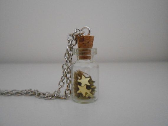 Mini glass bottle necklace with golden stars / di BlueBupCreations, €9.00