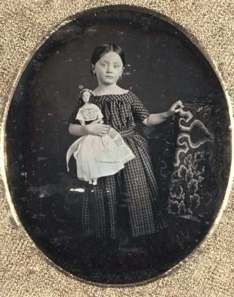 Girl with Doll, 1850s  Unidentified Photographer.  daguerreotype, sixth plate, Image - h:8.30 w:7.00 cm (h:3 1/4 w:2 3/4 inches) Case - h:9.10 w:7.90 cm (h:3 9/16 w:3 1/16 inches) Matted - h:60.98 w:48.26 cm (h:24 w:19 inches). Gift of Charles Isaacs and Carol Nigro 2003.300  Cleveland Museum of Art