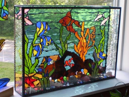3D Fish Tank AmberLyn's STG - <p>This fish tank is made with water glass and actually looks like moving water as you pass by it.  I had also 3D pieces inside (plants with fish attached)  and glass bobbles and shells in the bottom.  It is back lit at the clients house and actually fooled her guests into taking a second look to see if it was real!</p>