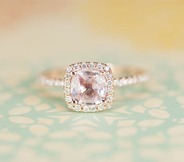 Certified Peach Pink Cushion Sapphire Diamond Halo Engagement Ring 14K Rose Gold. $1,020.00, via Etsy. ....But seriously, I love things like this.