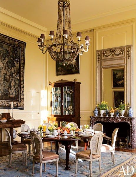 A dining room is furnished with a 17th-century Aubusson tapestry, a Regency rosewood cabinet, a 19th-century English table, and Louis XVI chairs | http://archdigest.com