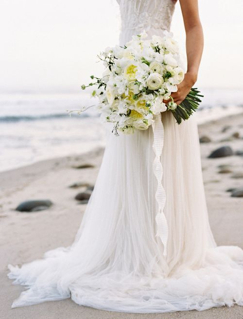 Not typically a fan of beach weddings, but this dress and bouquet is stunning.