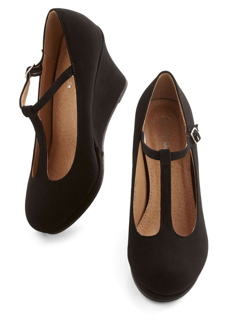 Dashing to Dinner Wedge in Black. When counting down the minutes before dinner with the girls, you dont think twice about slipping your feet into these black wedges for an instantly chic look! #black #modcloth
