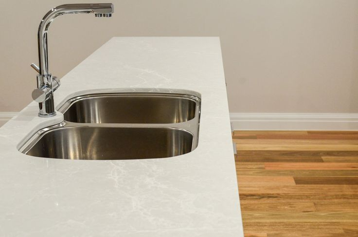 Complete Kitchens featuring Caesarstone Alpine Mist island bench top.
