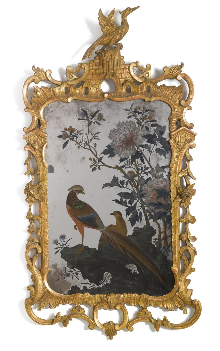 A Chinese export reverse-painted mirror within a George III giltwood frame, third quarter 18th century, The frame re-gessoed and re-gilt, restorations to frame. height 45 in; width 23 1/2 in. 114.3 cm; 59.7 cm New York 2012, 37,500 USD
