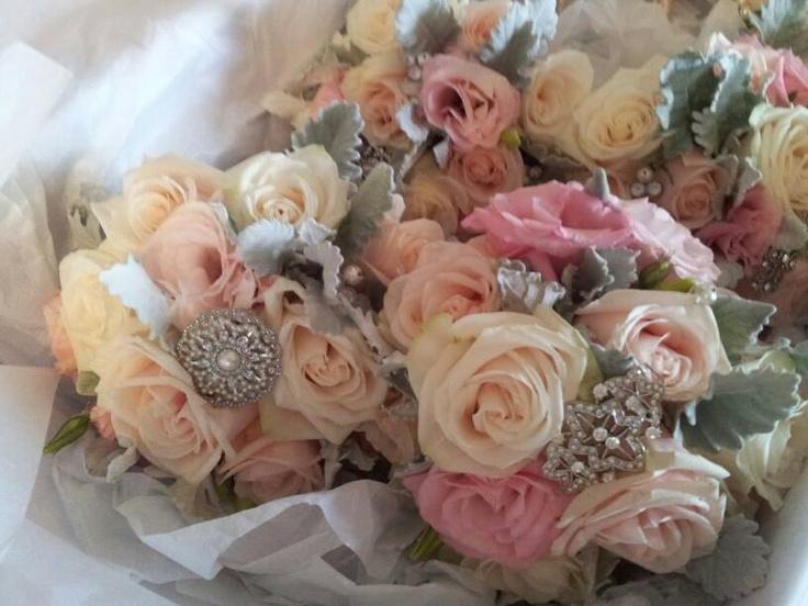 soft open roses, dusty miller and lisianthus with vintage brooches (www.bowerbirdweddings.com.au)  www.jademcintoshflowers.com.au