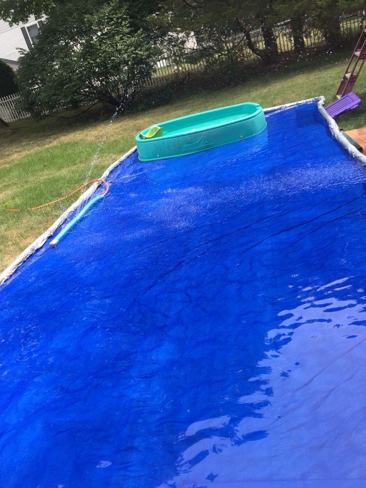 Backyard splash pad  One tarp with pool noodles rolled and sewed with fishing line.  My little boys use it to splash in and my teen uses his skimboard on it.