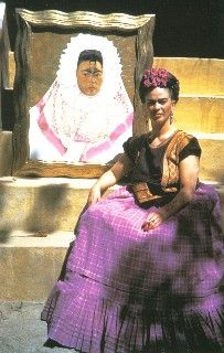 Frida Kahlo sits in front of her Self Portrait as a Tehuana. Photo by Florence Arquin, ca.1942 (for Mexican Vogue?)