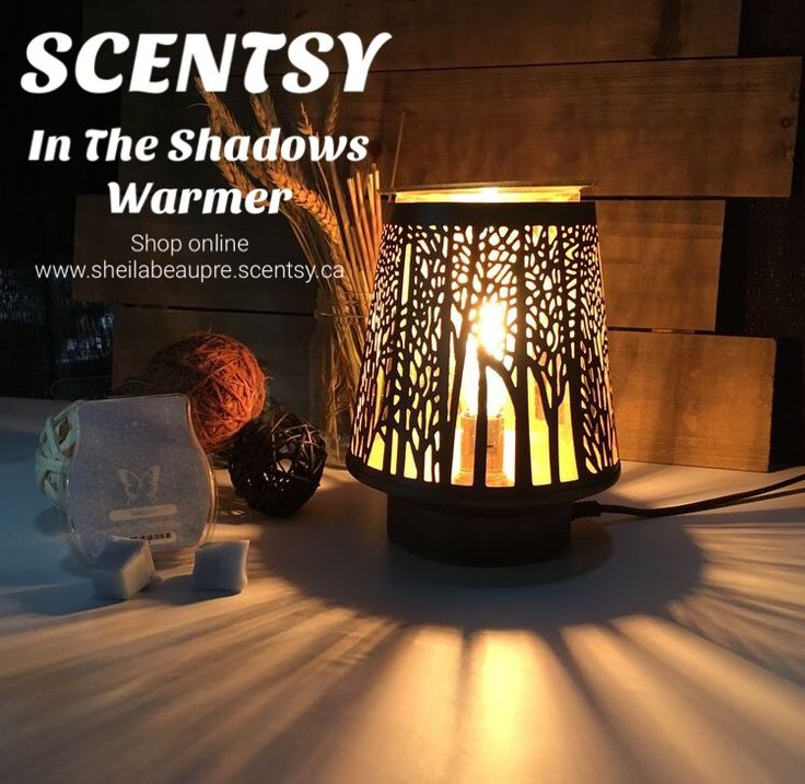 SCENTSY WARMER ~ Lifetime Warranty  Follow In the Shadows toward a dreamy forest scape glowing with a warm, inviting purpose.