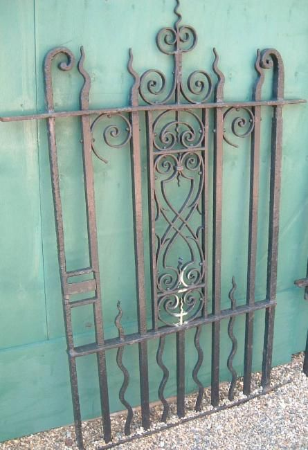 Victorian wrought iron entrance gates with wall mounted railings,