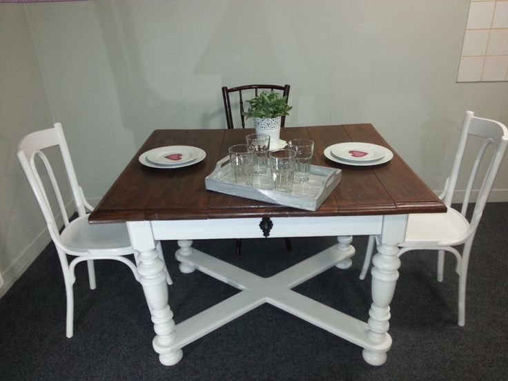 A beautiful, old brown/white dining table with 2 brown and two white chairs