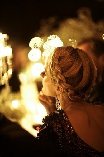 Braid your hair around in the back instead of over the top for a hairstyle that's more appropriate for night time.