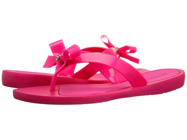 GUESS Women's Tutu Flip-Flops in pink are easy to slip on are super lightweight and comfortable.  As you can see, these flip-flops are super cute with their bows and gemstones and they would be perfect for pool side or dress-up occasions.