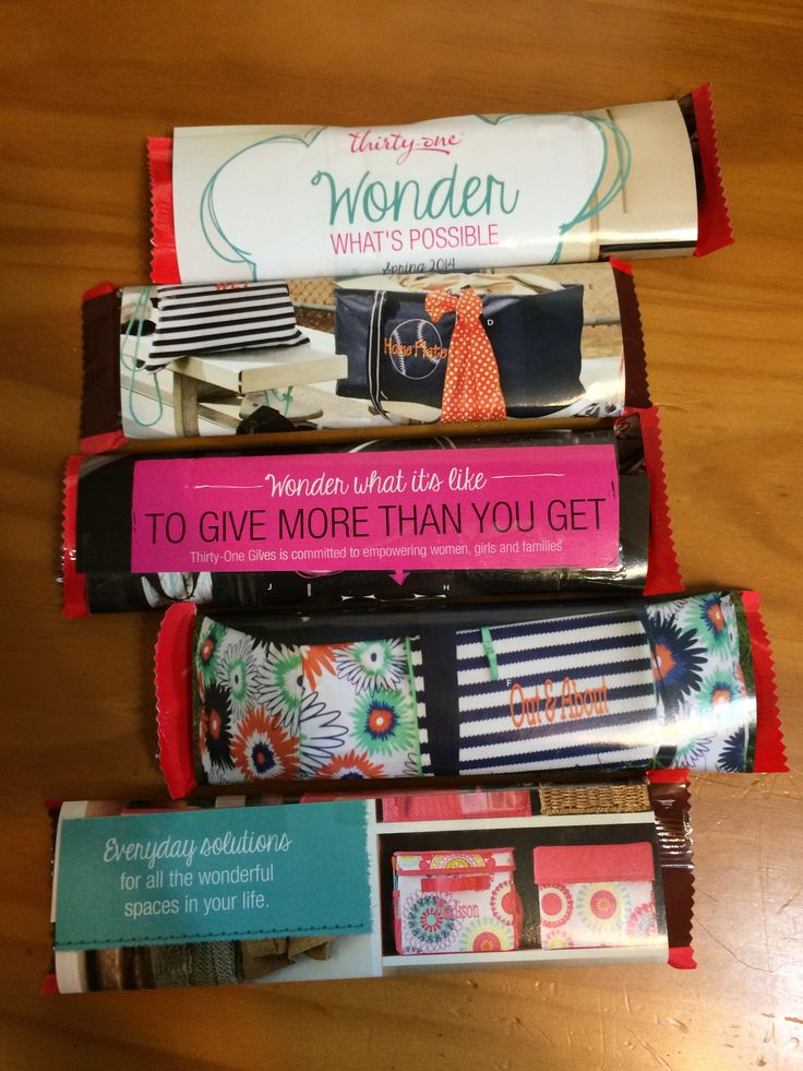 Use up old Thirty-One catalogs by wrapping candy bars in the pages and use them as giveaways or team gifts! Such a cute idea!
