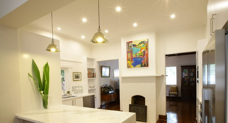 Kitchen renovation featuring marble bench tops and vintage fireplace