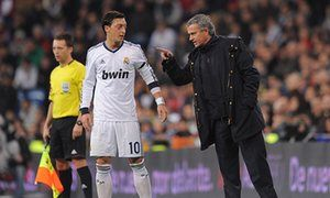 José Mourinho, manager, gives instructions to Mesut Özil during their time together at Real Madrid.