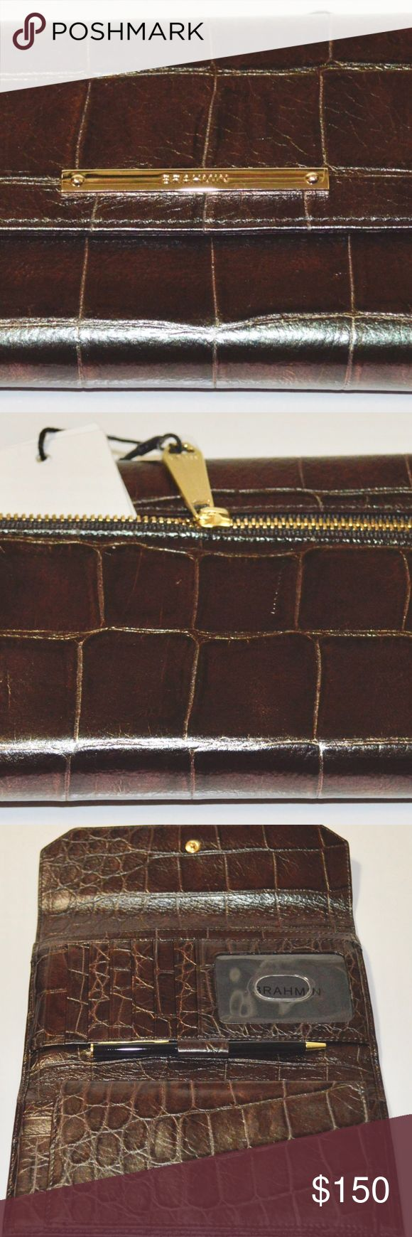 Brahmin Soft Checkbook Wallet - Petrol Versilia BRAHMIN PETROL VERSILIA CROCO EMBOSSED LEATHER SOFT CHECKBOOK WALLET CLUTCH W/ PEN   FABULOUS NEW COLOR    TRULY A CLASSY RICH COLOR WALLET AND MUCH SOFTER LEATHER THAN TRADITIONAL MELBOURNE CROCO LEATHER  7.25x 1.25 x 4 approx  BRAND NEW & INCLUDES ORIGINAL TAGS AND REG CARD  MULTIPLE CREDIT CARD SLOTS PLUS PHOTO ID SLOT  3 BILL HOLDER SLOTS  FULLY LINED INSIDE WITH MATCHING LEATHER   SNAP CLOSURE Brahmin Bags Wallets