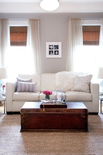 Neutral living room - white area rug, nice blinds and curtains