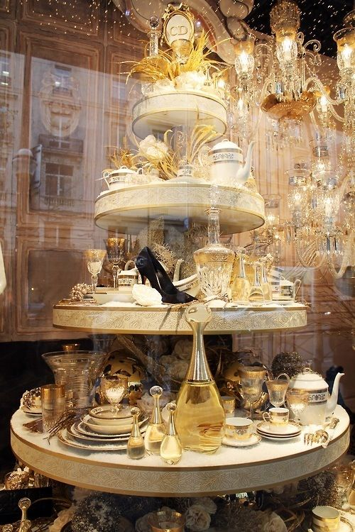 Closed Display , Rounded Tiered Tables , Props include place settings , Chandelier Lighting , Gold Color , CIrcles , Formal Balance , Shoe