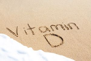 Vitamin D is a fat-soluble vitamin that your body makes after exposure to ultraviolet (UV) rays from the sun. Vitamin D functions as a hormone because it sends a message to the intestines to increase the absorption of calcium and phosphorus. By promoting calcium absorption, vitamin D helps to form and maintain strong bones.