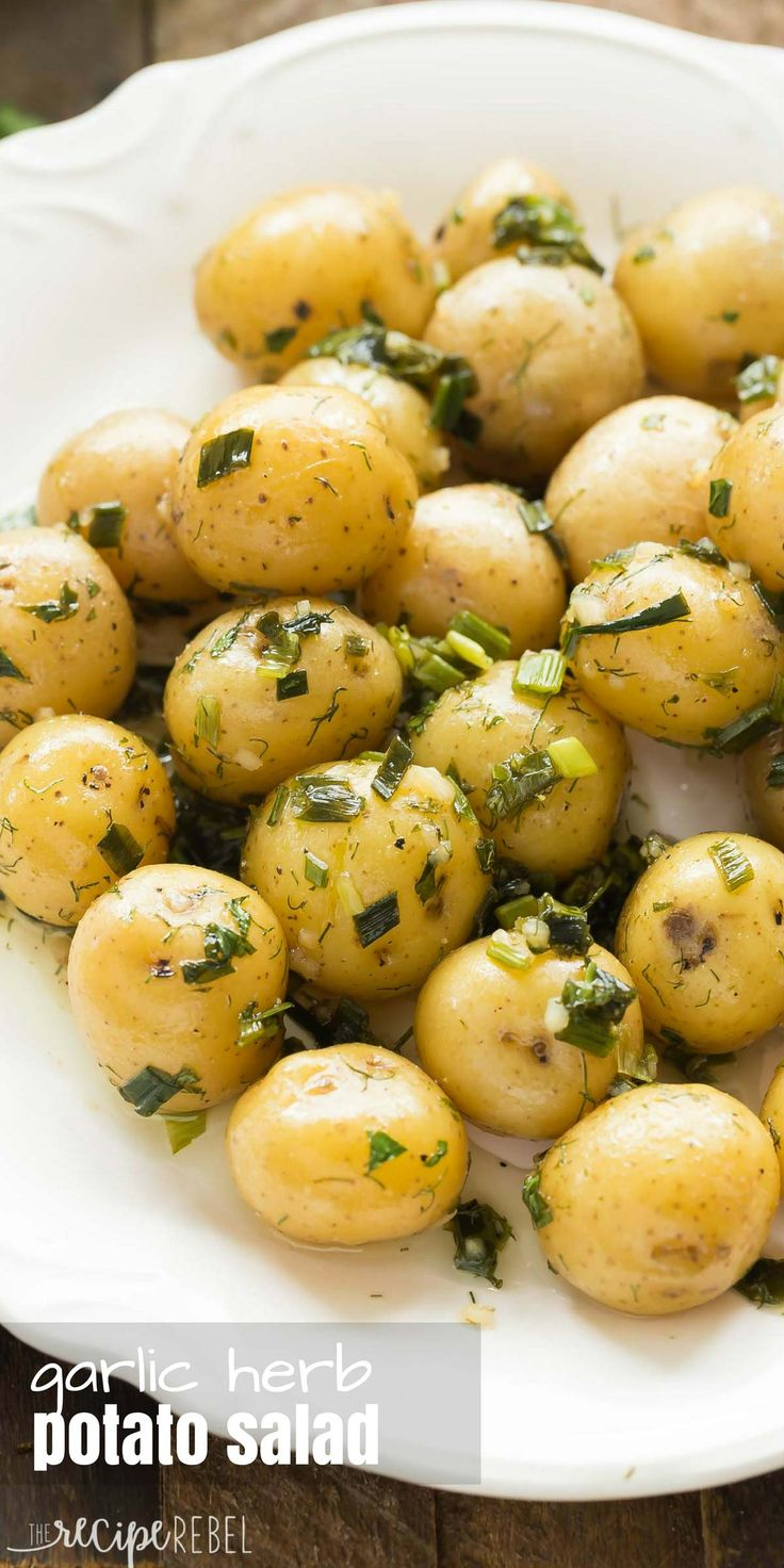 This no mayo Garlic Herb Potato Salad is great warm or cold -- the perfect make ahead side dish for summer barbecues, loaded with fresh herbs! Includes step by step recipe video. | light recipe | low calorie | diet | healthy recipe | healthy side | summer salad | warm potato salad |