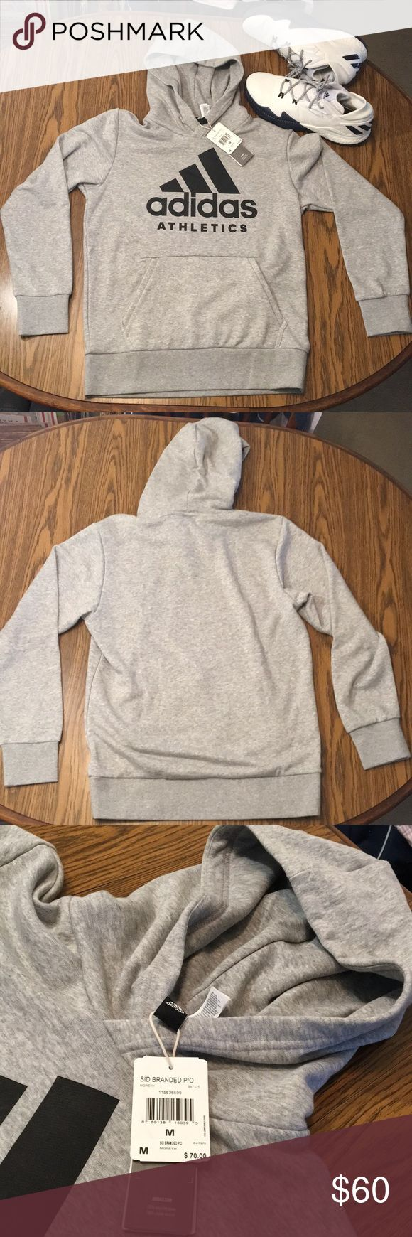 ADIDAS SID BRANDED P/O HOODIE MEN MEDIUM NWT ADIDAS SID BRANDED P/O HOODIE MEN MEDIUM NWT THIS HOODIE FEATURES A POCKET ON THE LEFT INSIDE OF HANDWARMER WITH ZIPPER Measurements 27 inches from collar down to waist  22 inches from pit to pit Any questions please feel free to ask adidas Shirts Sweatshirts & Hoodies