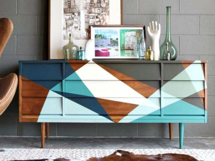 DIY Network has instructions on how to strip and prep wood furniture for a new multi-tone, paint and wood finish.