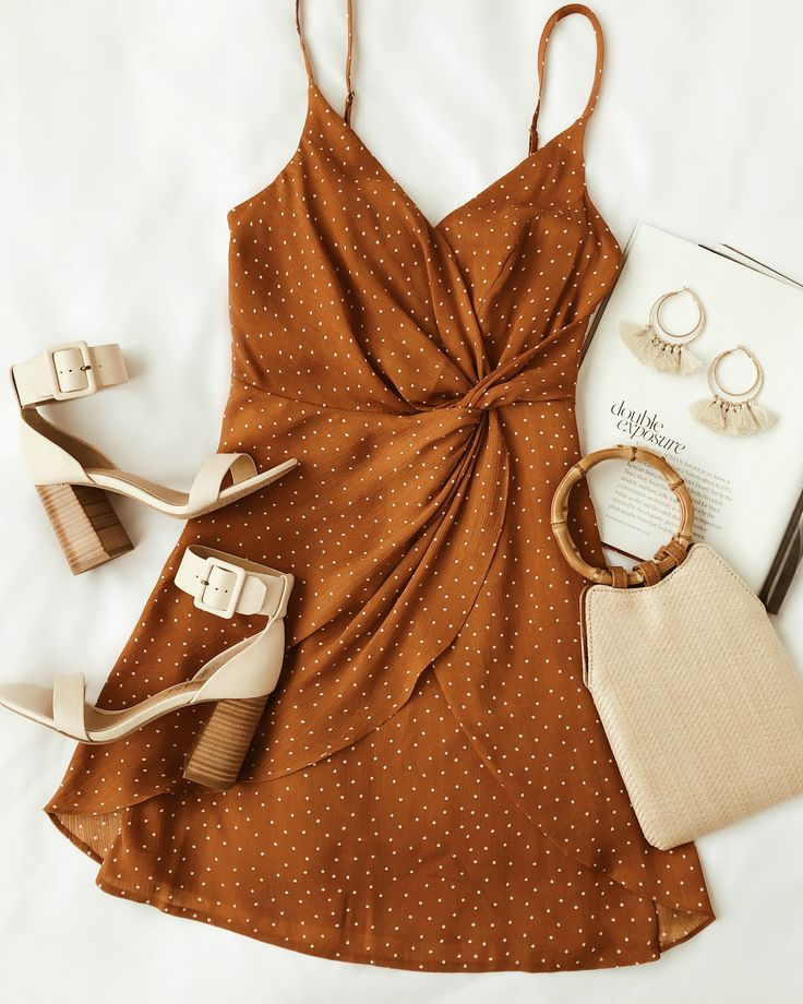 A rust-colored spotted wrap dress is a must-have this spring. This short dress has one
