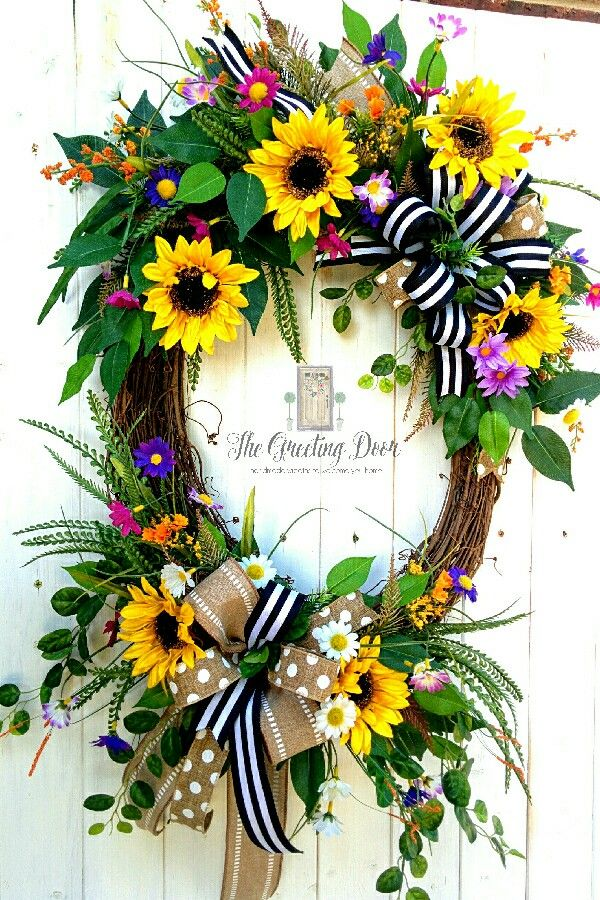 Summer sunflower wreath for your front door! This bright and cheery wreath is a great way to welcome your guests this summer.