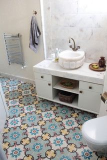 colorful encaustic tiles nicely set off the cool marble splashback in this neat bathroom