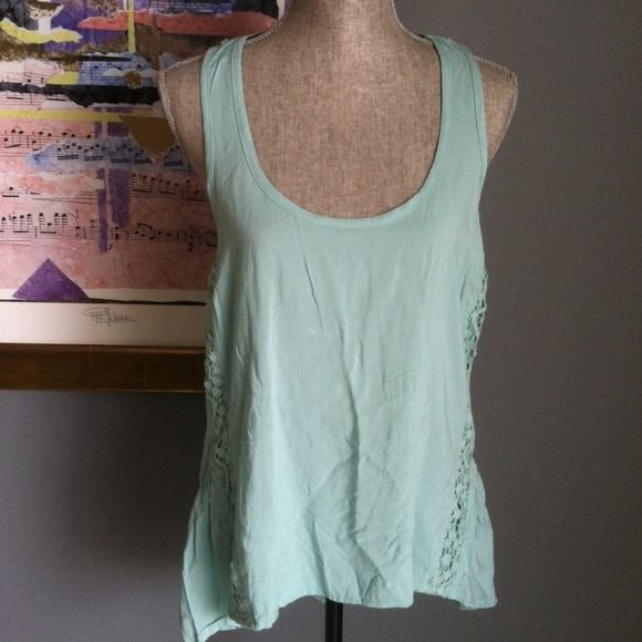 Top High-Low girly girl top by eyeshadow. Gorgeous lace details. Pretty sea mist color. Made of 100% rayon. Machine washable. eyeshadow Tops
