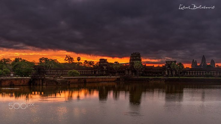 "Befor sunrise at Angkor Wat - Few minutes before sunrise was sky amazing. But if we came to the main building, all the beauty ended ...  Angkor Wat (Khmer: អង្គរវត្ត or ""Capital Temple"") is a temple complex in Cambodia and the largest religious monument in the world..."
