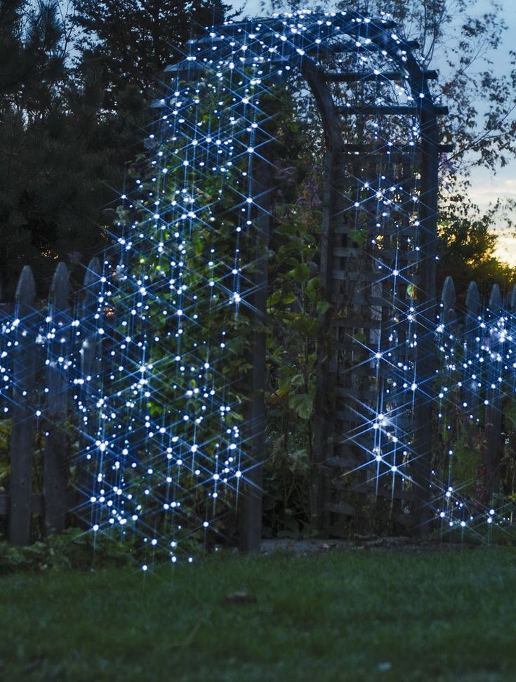 Solar Powered String Lights in white or blue feature super-bright LED bulbs and run for 8 hours on a full charge. This arbor is decked with 5 strings of lights. gardeners.com...I also really love the picture!