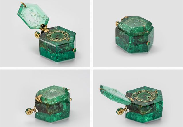 A watch set in a single large emerald of hexagonal shape, perhaps from the famous Muzo mine in Colombia. The loop is also set with small emeralds and with white enamel, and the face enameled green, circa 1600.
