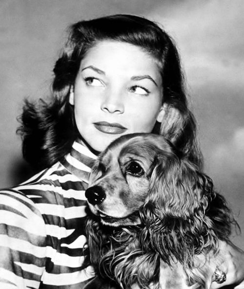 """Lauren Bacall with her beloved Cocker Spaniel """"Harvey"""", 1945. During Humphrey Bogart's battle with throat cancer during 1956-57, Harvey, no spring chicken himself by that point, would climb the stairs in their Holmby Hills home and rest by Bogie's side each day. Devastated by Bogie's passing on January 14th, 1957, Lauren lost Harvey to heart disease and old age not long afterwards. """"We treated that dog like one of our kids"""", she's written. """"He went everywhere with us, always cheered us up…"""