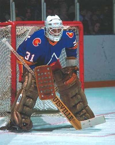 Plasse, who took over the brunt of the Rockies goaltending duties after Doug Favell's knee injury in mid-October, has taken to wearing a more-open Russian-style mask. Description from goaliesarchive.com. I searched for this on bing.com/images