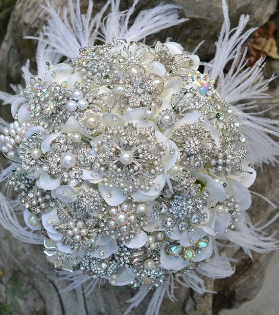 attempting to make something simular to this for jaimie. but with aqua and royal blue flowers. **seeking brooch donations from family and friends**