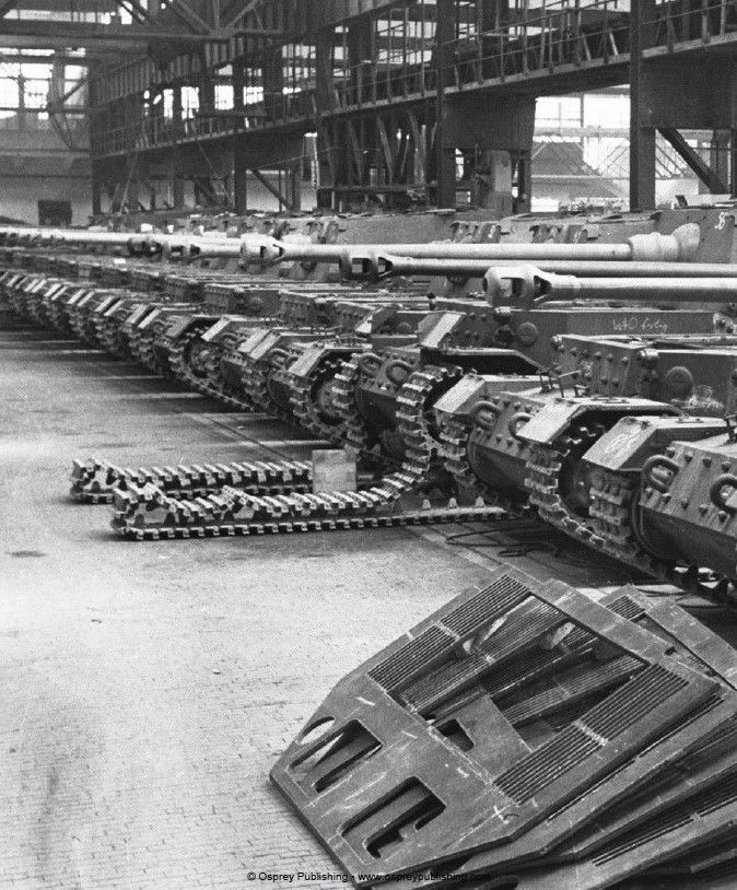 """German """"Elefant"""" tank destroyers on the assembly line. These were a Schwerer Panzerjäger (""""heavy tank-hunter"""") of the Wehrmacht during World War II, built in small numbers in 1943 under the name """"Ferdinand"""" after its designer, Ferdinand Porsche, using tank hulls that had been produced for the Tiger I tank requirement, but which were rejected in favor of the competing Henschel design."""