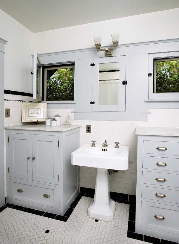 Compact Comfort in a Bungalow  by Sarah Hilbert. The black-and-white bath looks vintage, but only the medicine cabinet is original. Tub and sink were salvaged.
