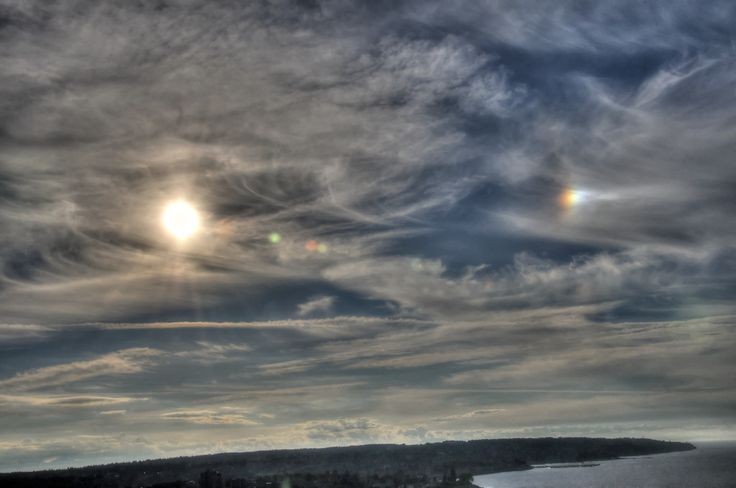 A shy sundog hovers over Vancouver's English Bay.