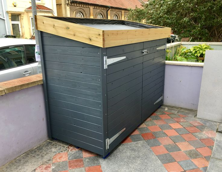 A Bluum Bike Shed, with green roof area ready to fill with succulents.