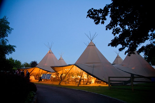 Never considered a teepee wedding tent, but it seems to work!