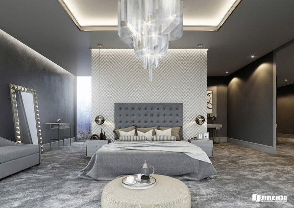 The first bedroom here, designed by Mauritz Snyman, uses soft and soothing grays and silvers to create a sparkling, luxurious feel. From an ultramodern chandelier that dangles over the bed to a plush silvery gray carpet that practically begs for your bare feet, waking up in this bedroom would be like waking up inside a warm storm cloud.